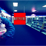 A movie consumer picks up overpriced movies from a Netflix kiosk at a local video store